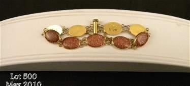 500: One ladies bracelet set with 9 sunstone cabochons
