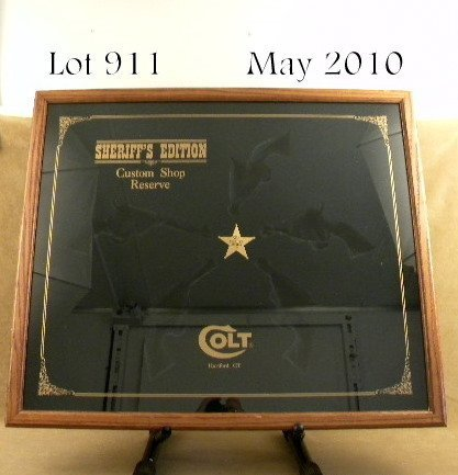 911: Colt manufactured custom oak and glass showcase,