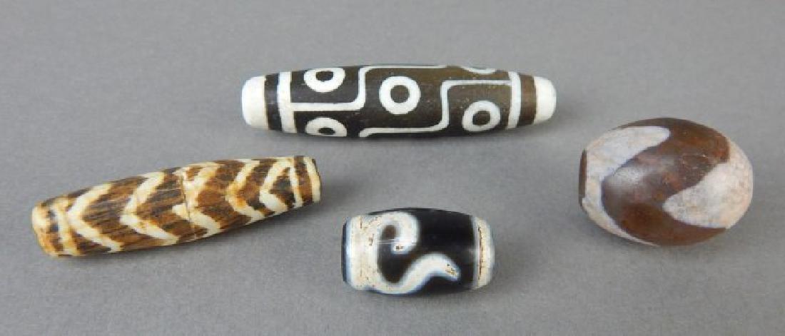 Three Dzi and One Nine Eye Beads