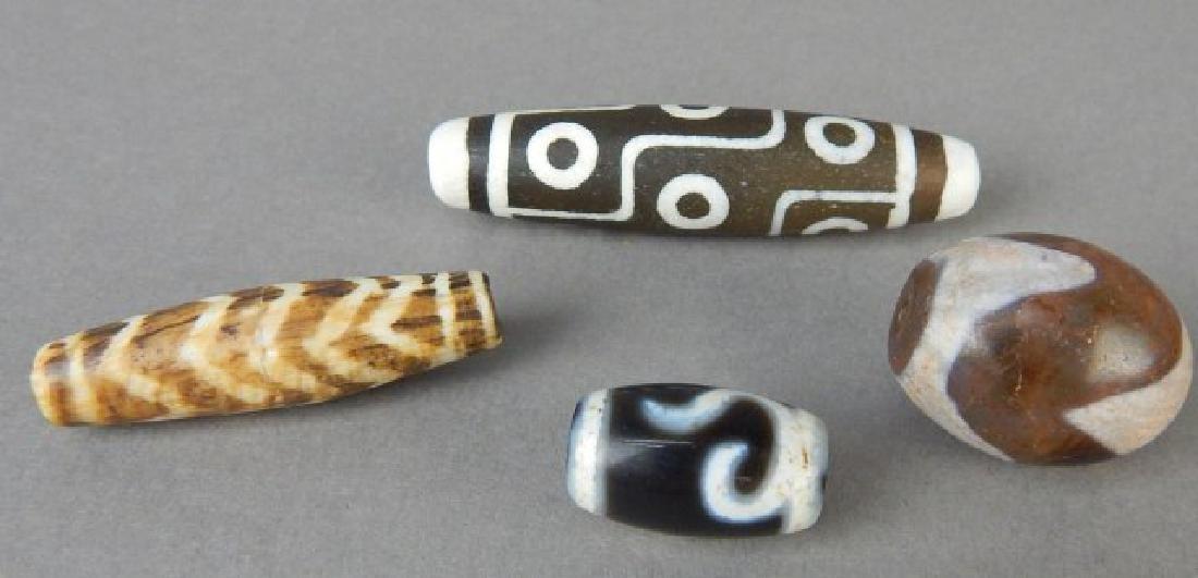 Three Dzi and One Nine Eye Beads - 2