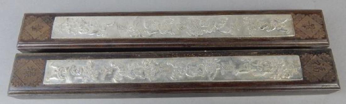 Two Scroll Paper Weights