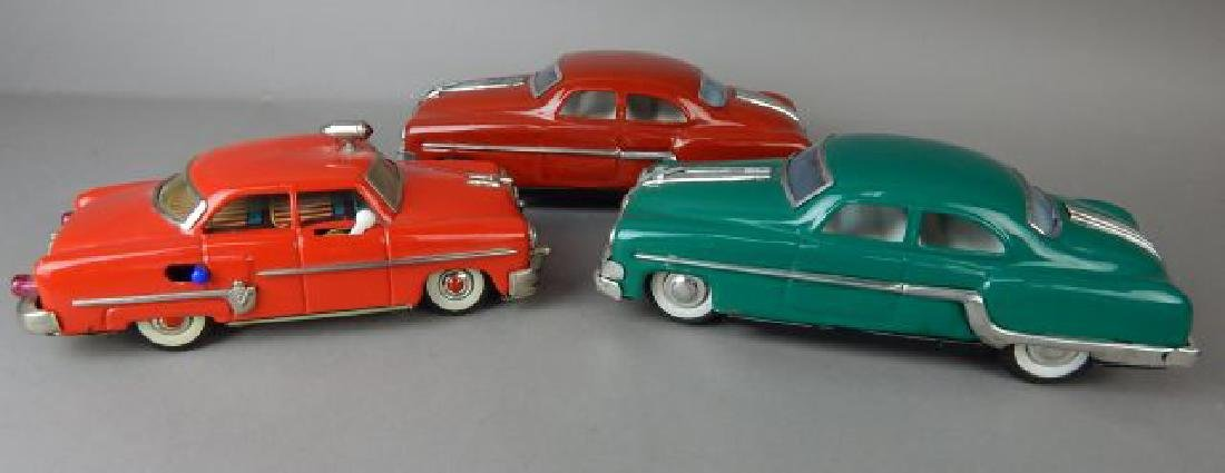 Three Tin Automobiles