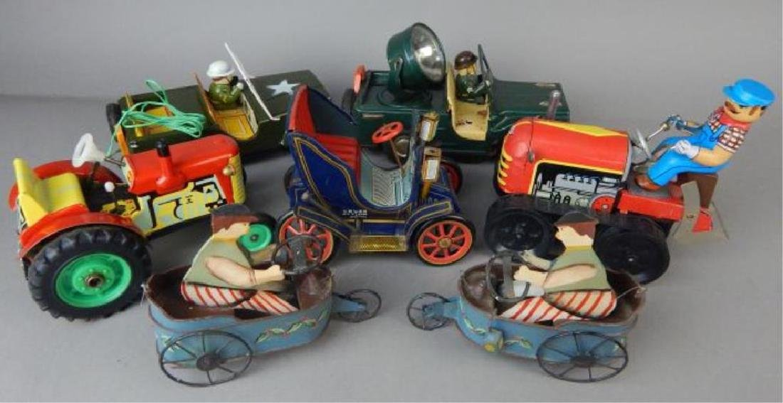 Seven Piece assorted Tin Toys