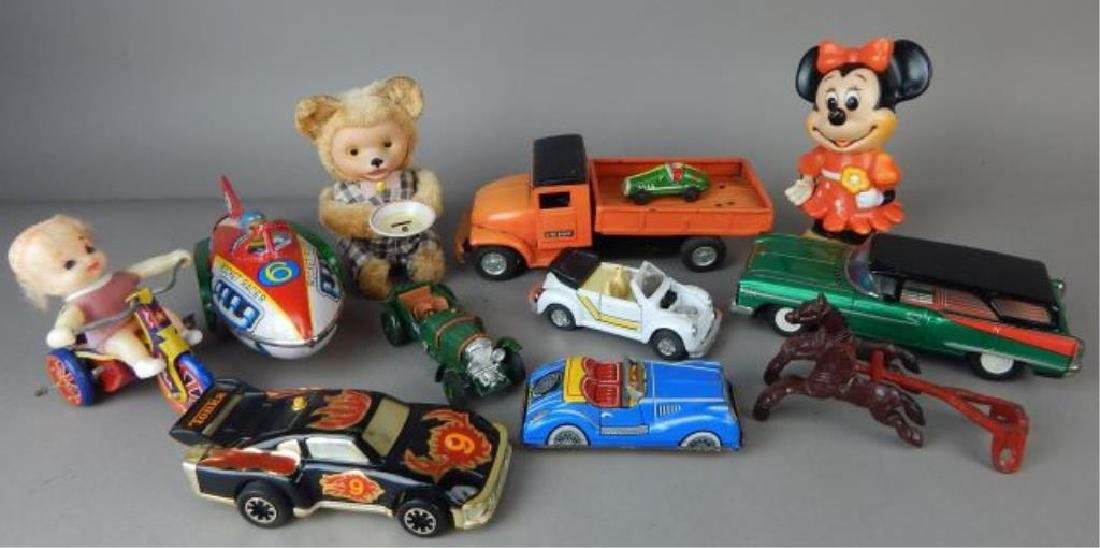 Collection of Twelve Tin, Plastic and metal Toys