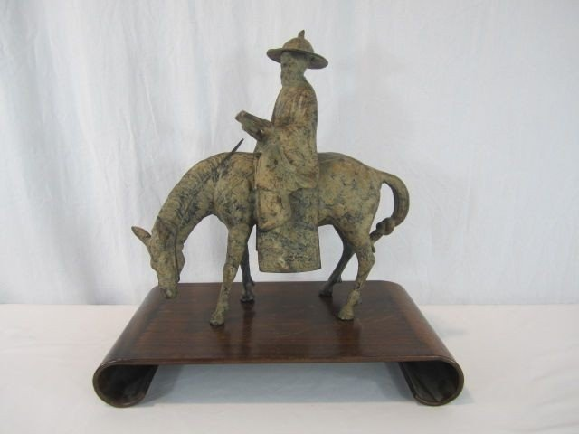 173: A58-1  MIXED METAL MAN ON HORSE STATUE
