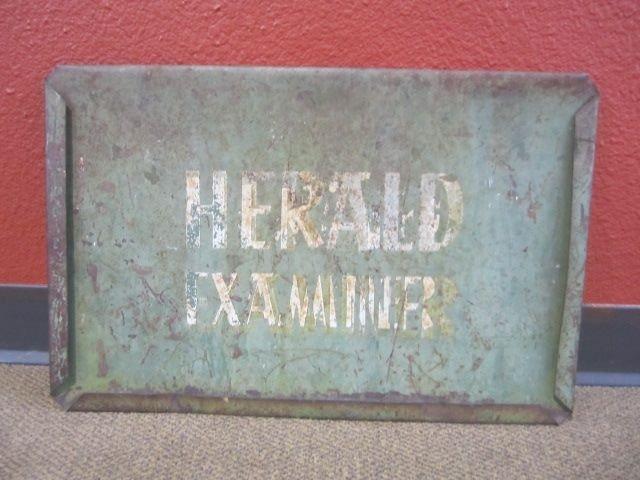210: A71-37  HERALD EXAMINER METAL SIGN