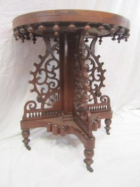 7: E33-7  ROUND CARVED PARLOR TABLE