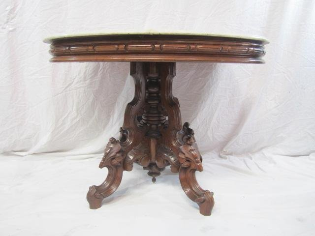 11: E33-11 OVAL CARVED MARBLE TOP PARLOR TABLE
