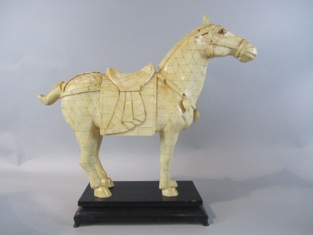 252: A80-2  CARVED BONE HORSE ON WOOD STAND