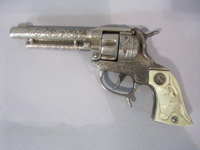 52D: H29-9  TEXAS CAP GUN