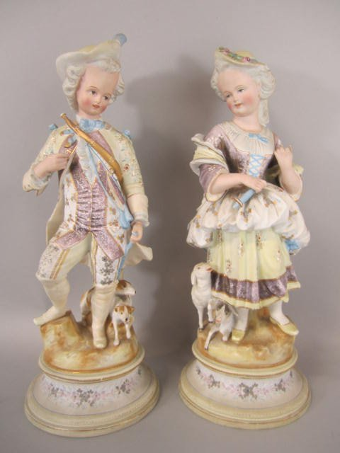 A23-37  PAIR OF BISQUE PORCELAIN STATUES
