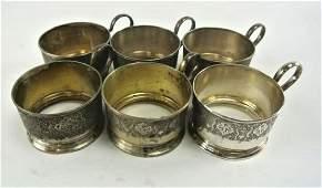 SIX RUSSIAN SILVER TEA GLASS HOLDERS