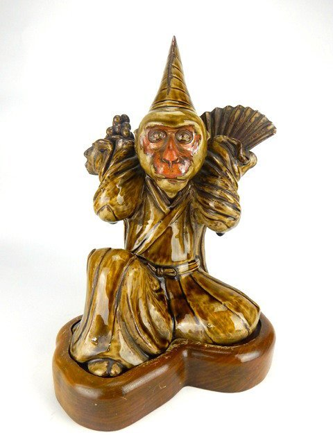 Chinese Porcelain Monkey on Wood Base