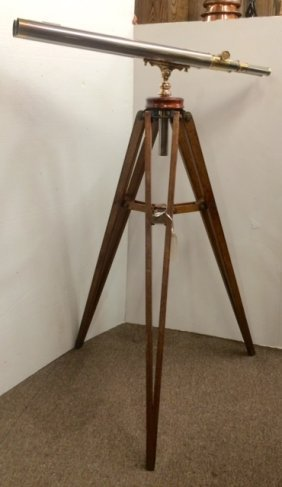 Double barreled brass telescope on tripod