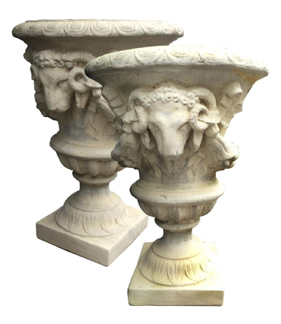 Pair of Belgian cast stone urns with rams' heads