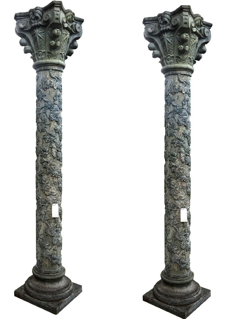 Pair of carved green marble columns with grapes