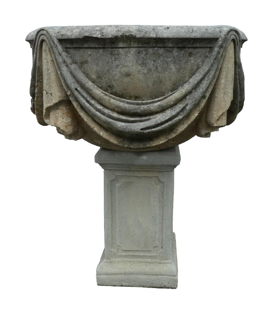 Classical garden urn with draped cloth