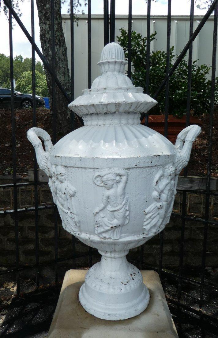 Cast iron relief cassoulet form urn