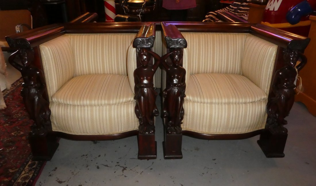 Pair American carved mahogany figural armchairs
