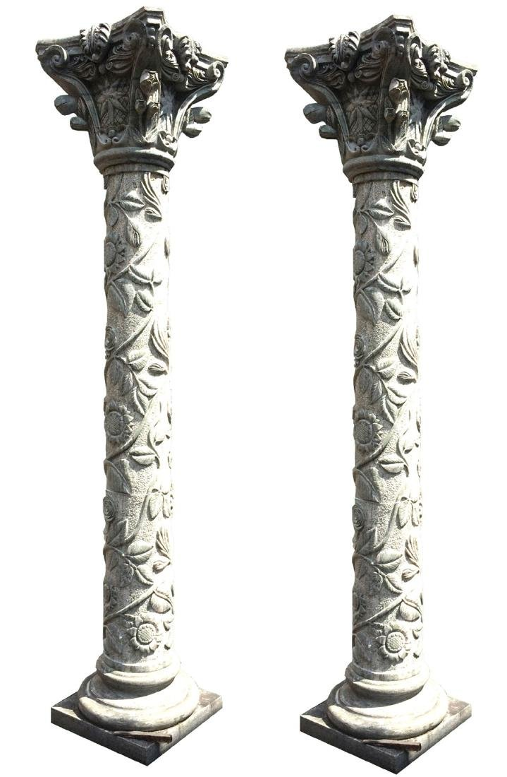 Pair of carved marble columns with sunflowers