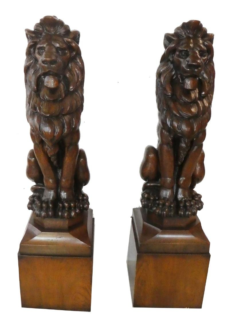 Pair antique relief carved oak seated lions