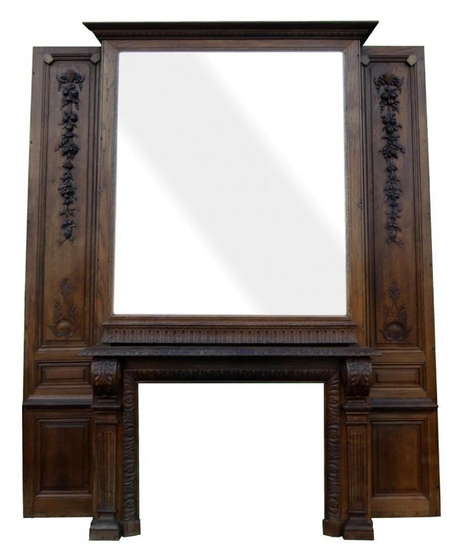 French Louis XVI oak mantel with over mirror