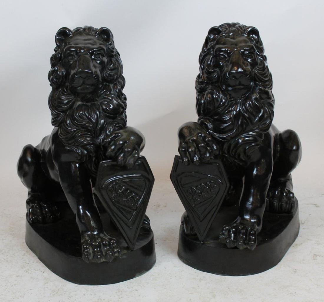 Pair bronze seated lions with shields
