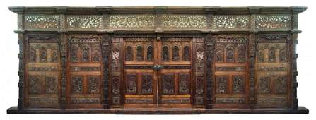 Heavily carved Indonesian teak entryway wall