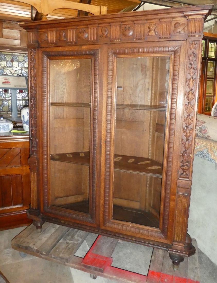 French carved oak corner gun cabinet