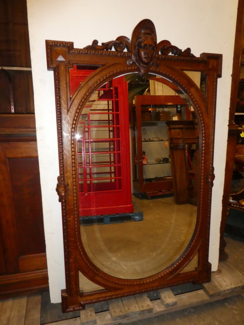American carved oak mirror with female mask