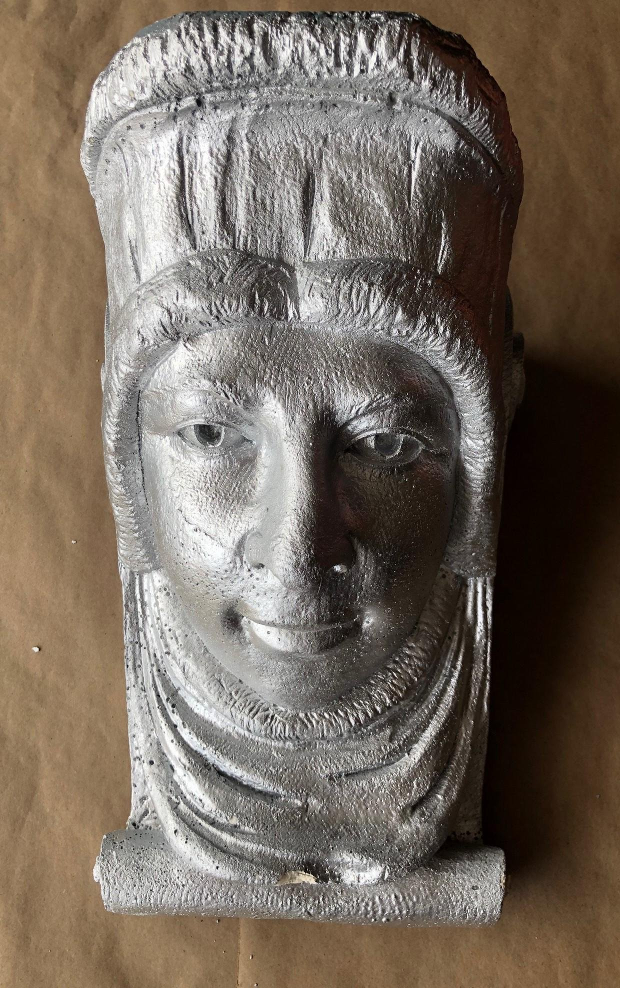 Cast corbel in the form of a head from a Cincinnati
