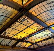 Stained glass ceiling with curved sides with fish and