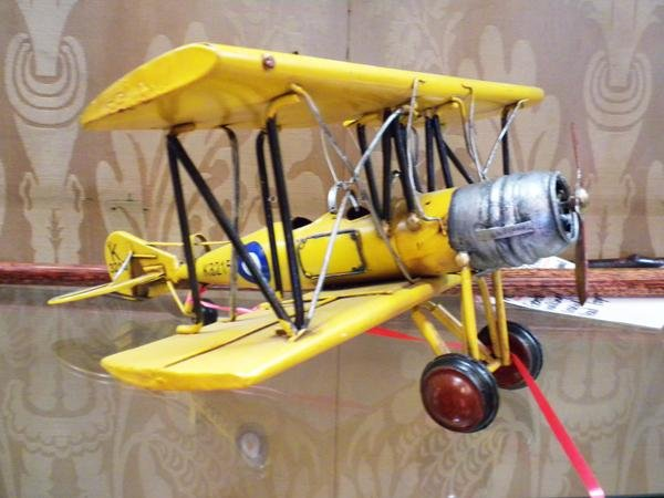 """19: Yellow tin toy K 3215 airplane. 7""""H x 13""""w"""