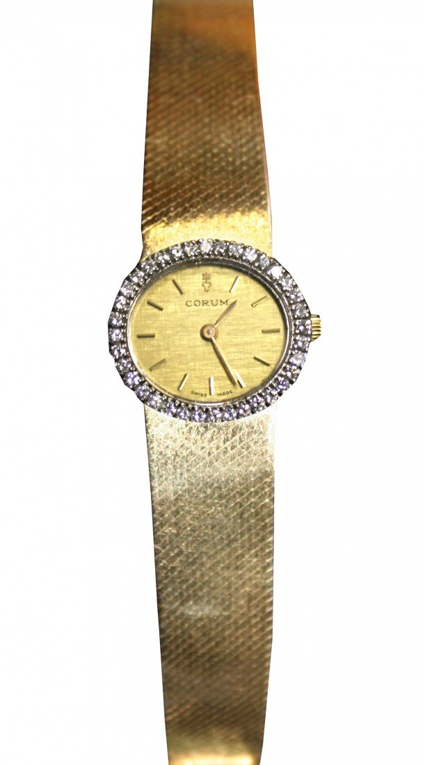 18: LADIES CORUM FACTORY WATCH IN 18KT YELLOW GOLD AND