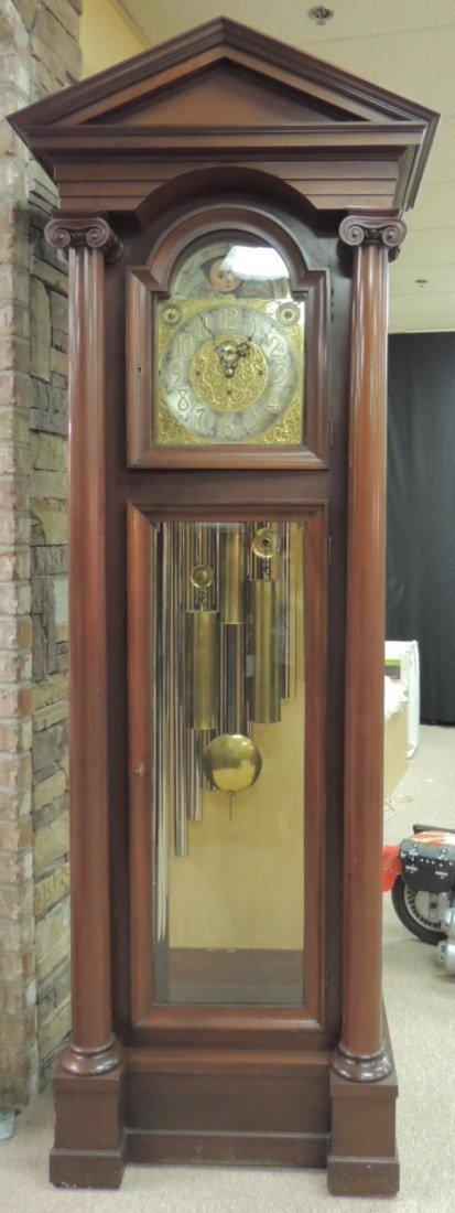 124: Tall case 9-tube Elliot mahogany clock