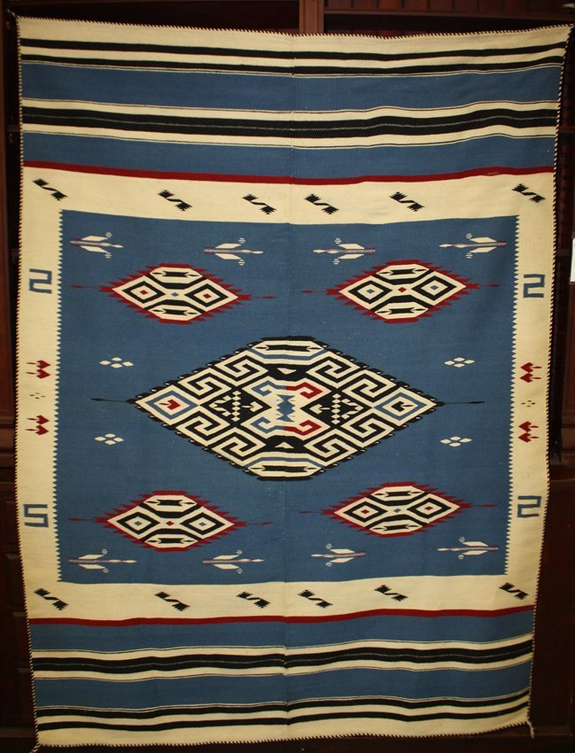 Navaho Blanket with white, black, blue, and red