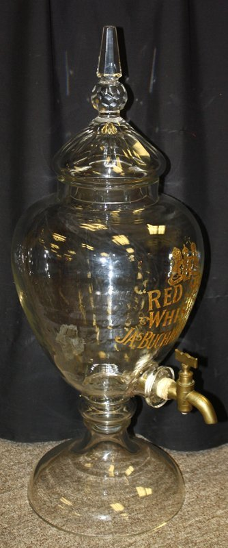 Large glass Red Seal whiskey dispenser by James