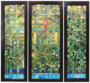 Tiffany Studios favrile glass triptych depicting