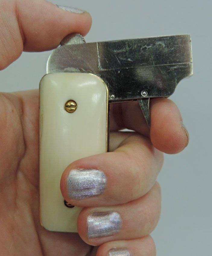 "Ladies' 1930s ""lipstick gun"""