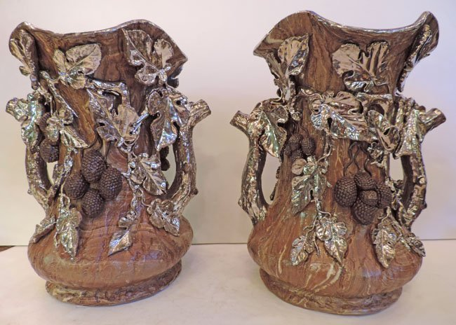 Pair of brown and silver pottery vases,