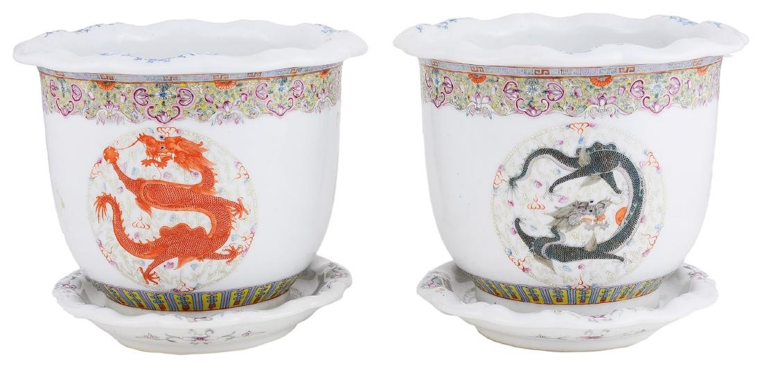 A PAIR OF CHINESE FAMILLE ROSE JARDINIERES AND STANDS