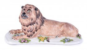 A SAMSON MODEL OF A RECUMBENT LION, CIRCA 1920 On A