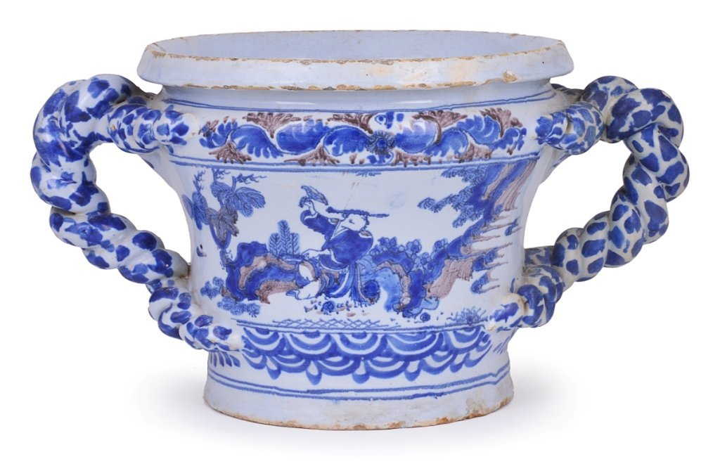 A NEVERS FAIENCE CACHEPOT, LATE 17TH CENTURY with twin