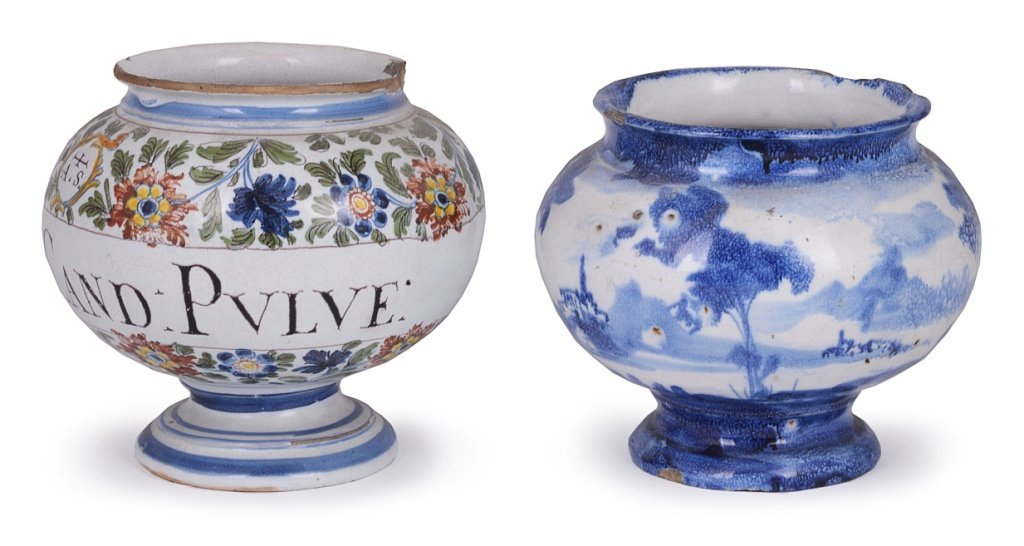 TWO ITALIAN FAEINCE DRUG JARS of footed spherical form,