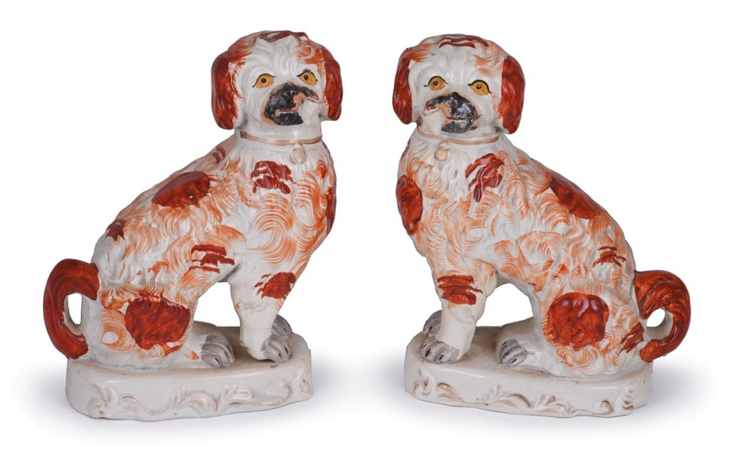 A PAIR OF STAFFORDSHIRE POTTERY SPANIELS, MID 19TH CENT