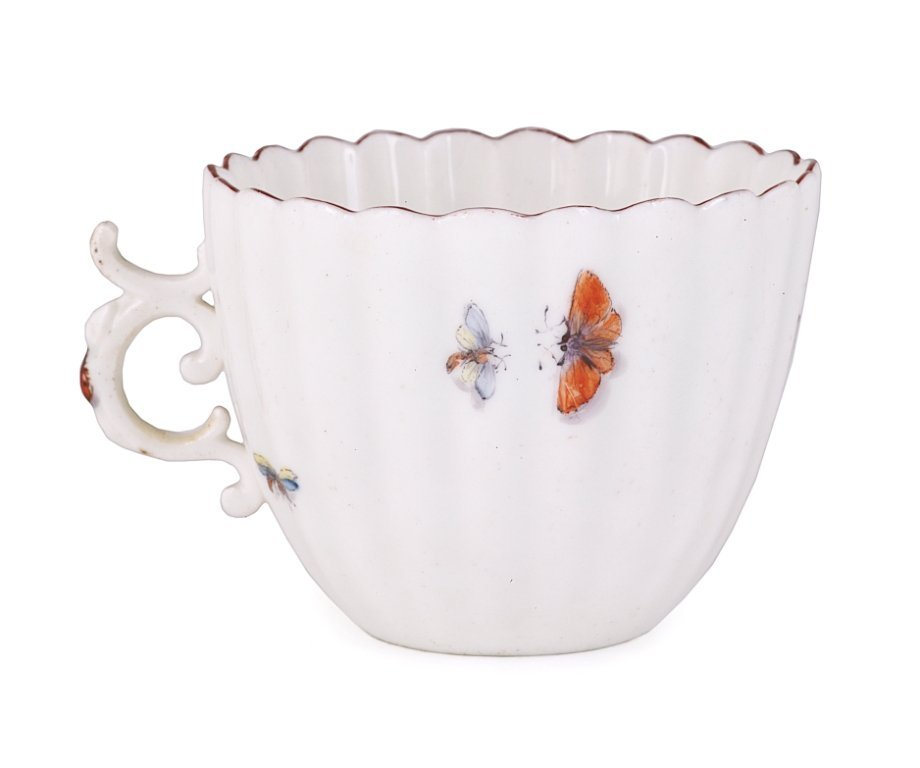 A CHELSEA FLUTED COFFEE CUP, CIRCA 1753-55 painted on t