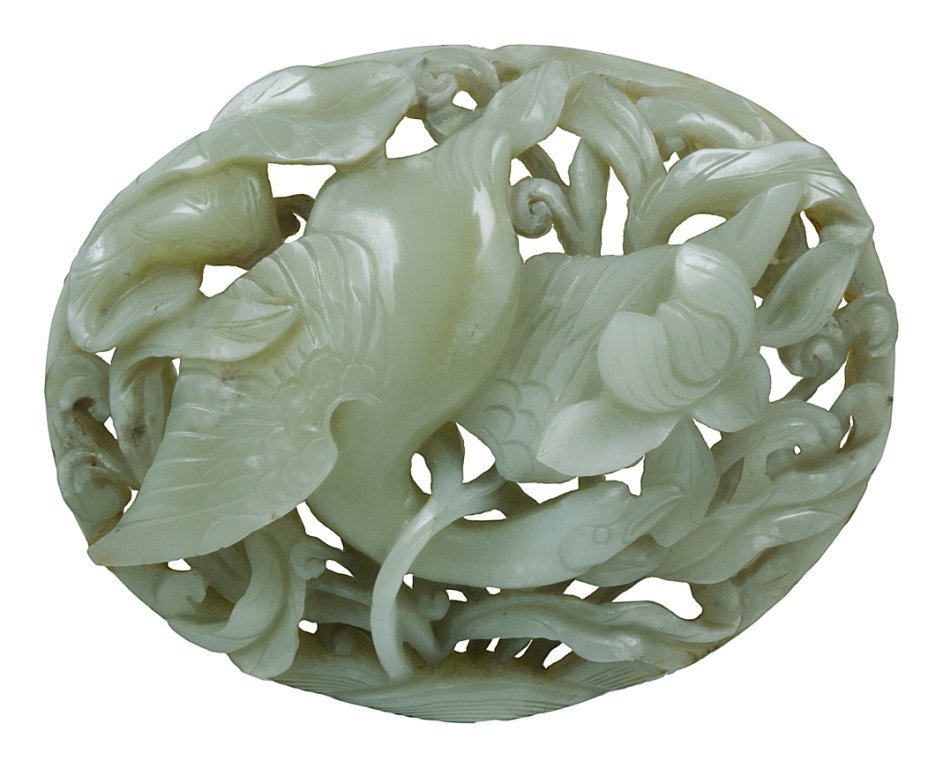**A CHINESE CELADON JADE OVAL PLAQUE, 18TH/19TH CENTURY