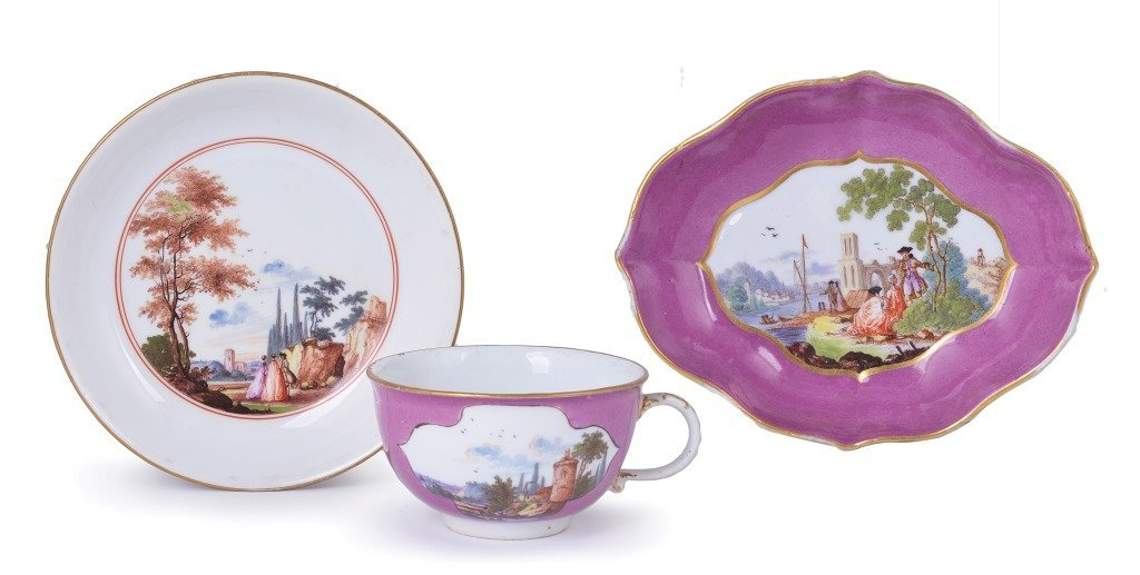 **A MEISSEN PURPLE-GROUND CUP AND SAUCER, CIRCA 1740-45