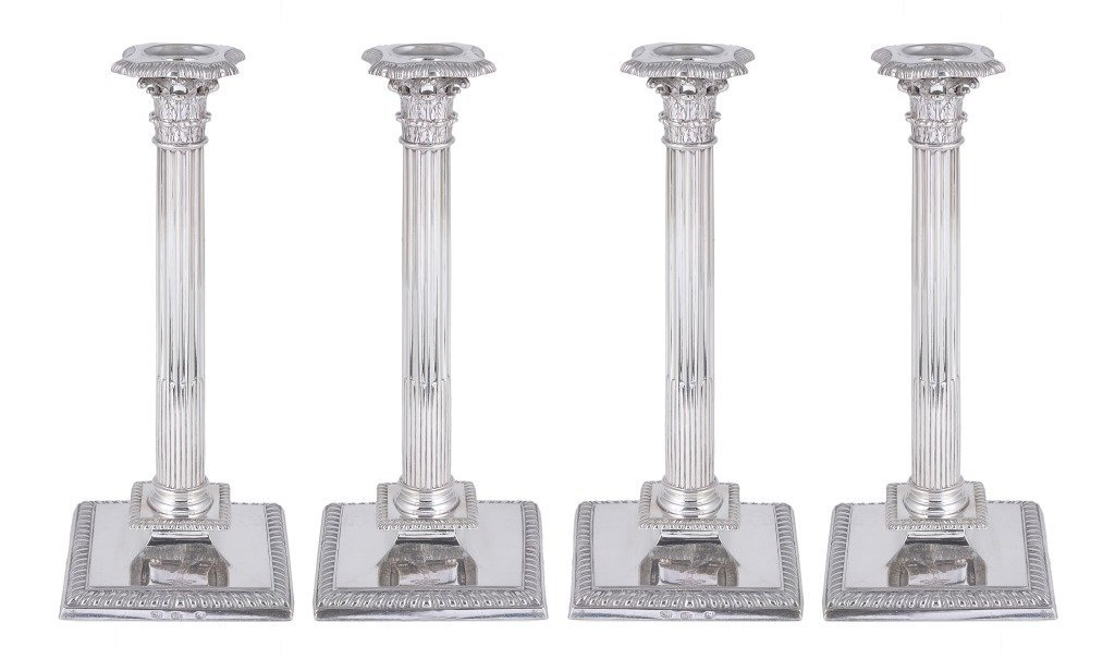 A SET OF FOUR IRISH GEORGE III SILVER CANDLESTICKS,