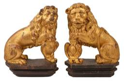 A PAIR OF GILTWOOD LIONS, ENGLISH, LATE 17TH CENTURY